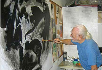 Murry Handler- painting The Human Condition Triptych in his studio
